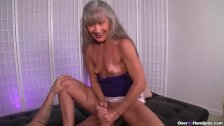 Mature slut jerking a young man