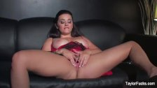 Naturally busty Taylor toys her wet pussy