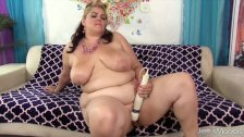 Buxom Bella shows off her fat ass and uses sex toys