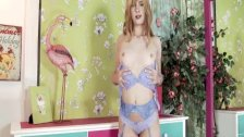 Sweet blonde teen strips and plays in delicate lingerie and pink stockings