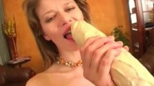 Tight brunette fills her pink pussy with a thick dildo