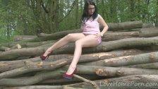Lovely brunette chick in the forest masturbating