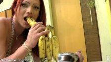 Charming redhead shedoll licks her round tits and banana too