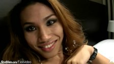 Attractive redhead ladyboy smokes and strips into lingerie