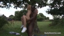 Black guy fucks skinny little blonde outdoors
