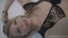Beautiful blonde in black lingerie records herself