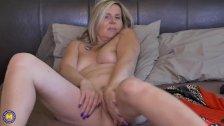 Natural blonde mature fingers herself