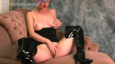 Babe with big natural tits masturbates pussy in slutty black leather boots
