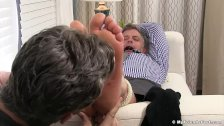 Aged yuppie Brendan Cage is restrained and foot worshipped