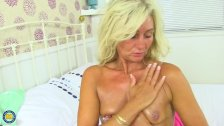 Blonde mom undressing and masturbating