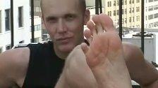 Blonde jock licking his own hot feet