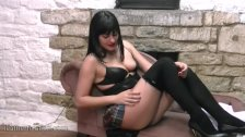 Kinky schoolgirl babe dressed in leather bra corset boots with whip in hand