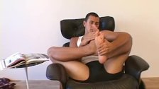 Horny young man sucking on his gorgeous toes