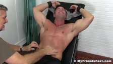 Handsome studs feet and chest uncovered and tickled
