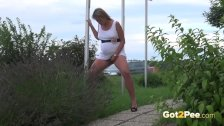 Blonde pees in public outside