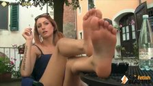 Barefoot redhead shows off cute feet in public