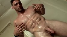 Young hunk Elijah Knight pissing before solo masturbation