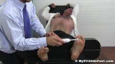 Businessman Daxx cannot escape severe feet tickling