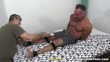 Hunky daddy restrained for relentless tickling