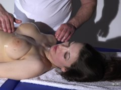 Busty brunette had an orgasm on a massage