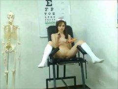 Sexy Brunette Nurse Plays With An Orange Dildo