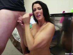 Sexy brunette milf jerking a cock