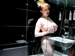 Redheaded Hookers Showers With Her Nylons On As She Rubs Her Twat