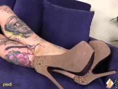 Barefoot Blue Eyed Tattoed Lady Gives Herself A Sole Massage