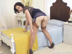 Sexpot Belle O'hara Is Pantyless Masturbating In Retro Garters And Nylons