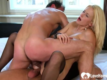 Blonde slut takes two hard schlongs at once