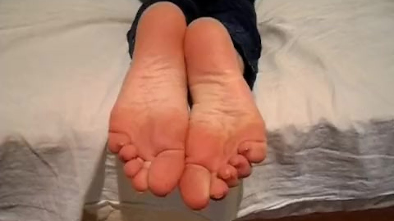Young girl's sexy feet in socks, and bare