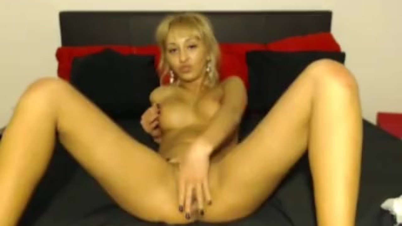 Busty blonde Brianna plays with her tight pussy