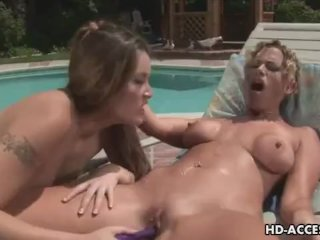 Hot lesbians playing by the pool