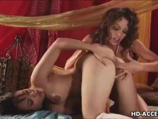 Big tit lesbian couple gets it on
