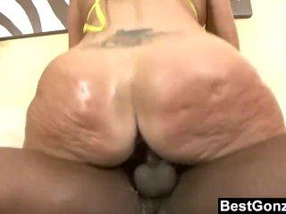 Milf shakes her big butt on black dick