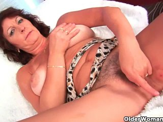 Busty Granny Rubs And Fingers Her Hairy Cunt