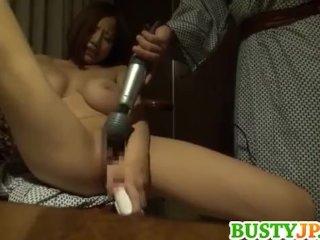 Busty Japanese uses vibrator