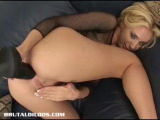 Kelly Wells Stretches Her Ass With Big Dildo