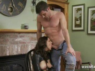 Restrained brunette sucks her Masters cock