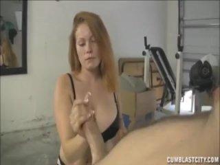 Busty redhead handjob