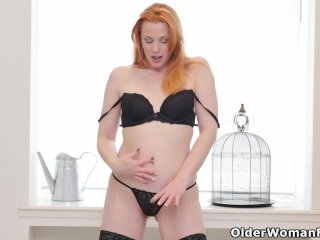 Euro milf Michelle Russo fingers her shaven pussy