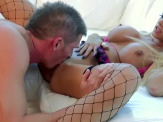 Big load of cum landing on a busty blonde's tits