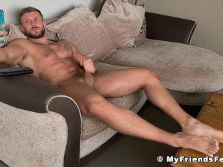 Barefoot muscle hunk Ryan Yule wanking big cock for camera